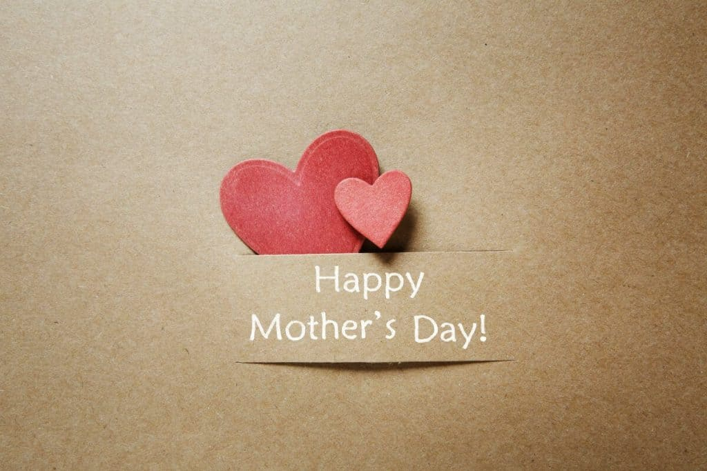 "Front of a greeting card with hearts and a ""Happy Mother's Day"" caption"