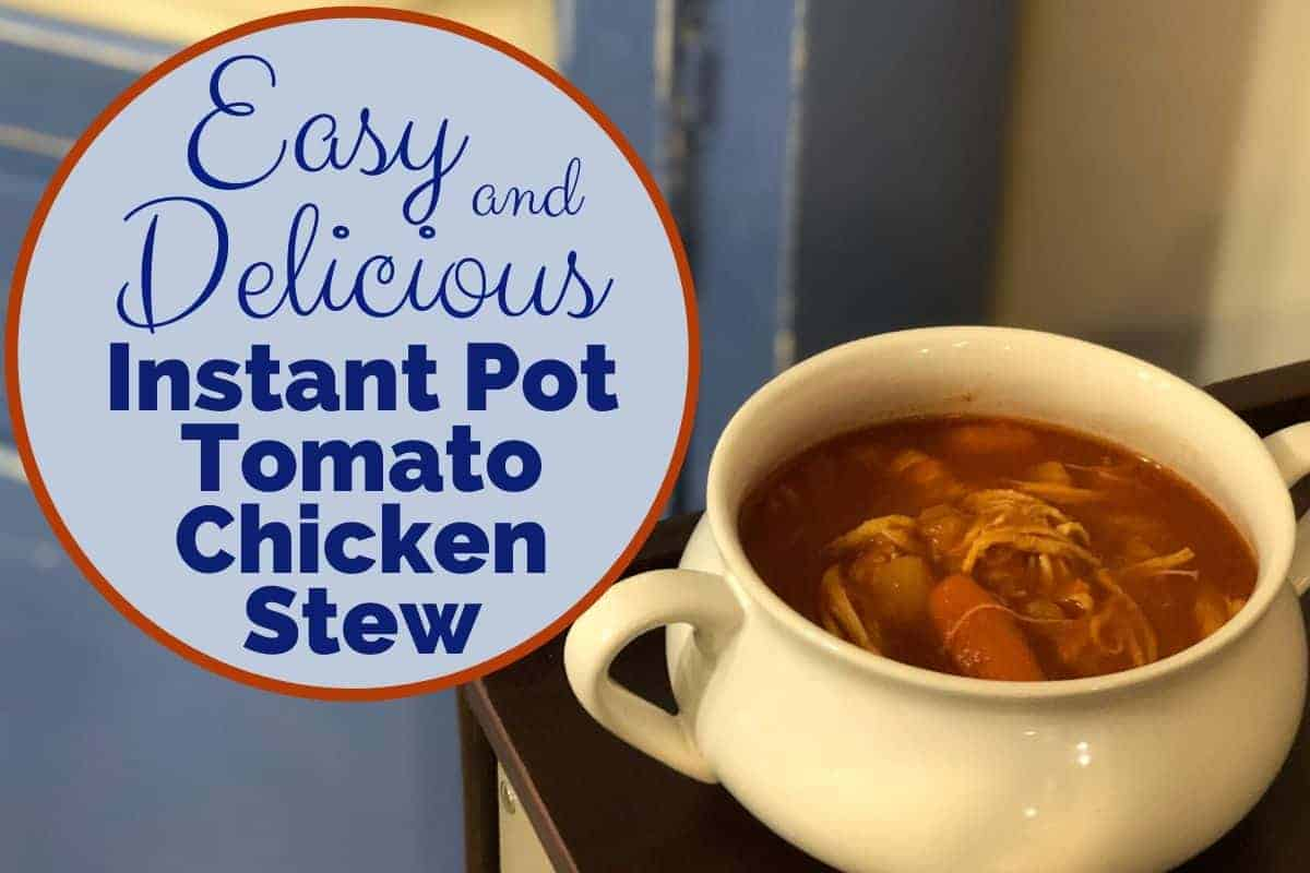 Tomato chicken stew from instant pot in a white bowl infront of blue cabinet