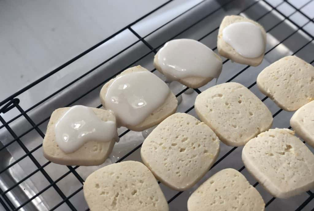 Easy Iced Lemon Cookies in process of being iced