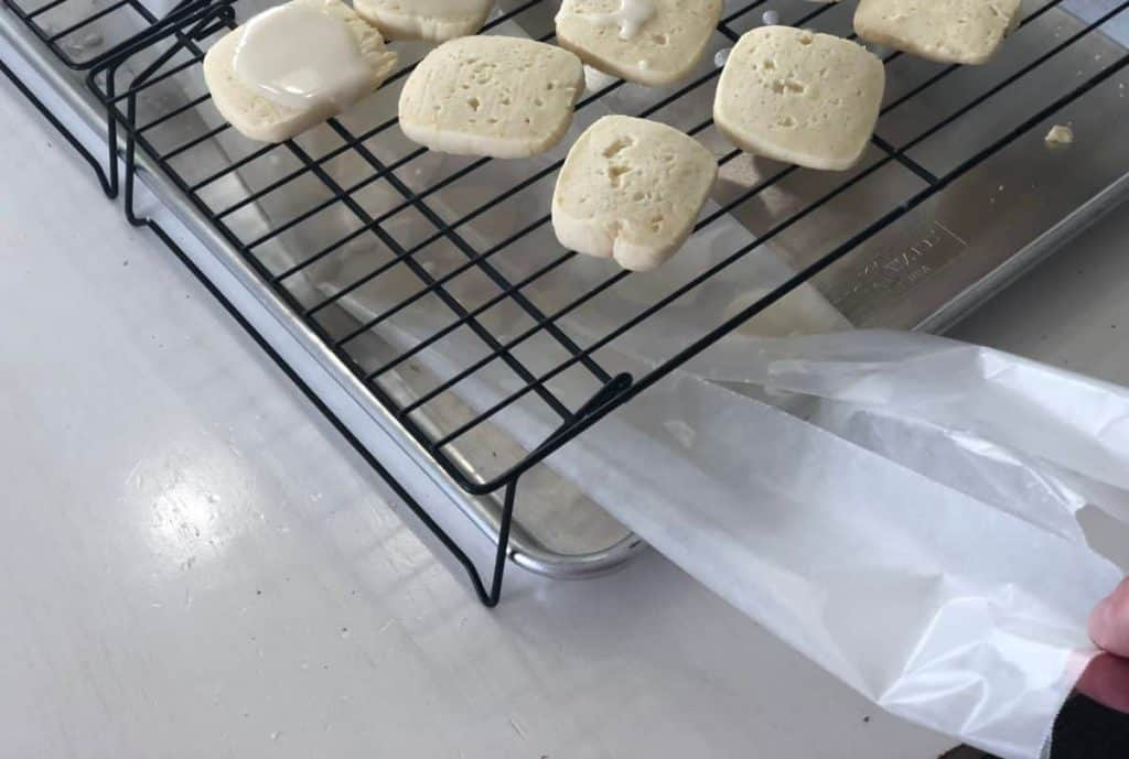 Easy Iced Lemon Cookies cooling on a cooling rack