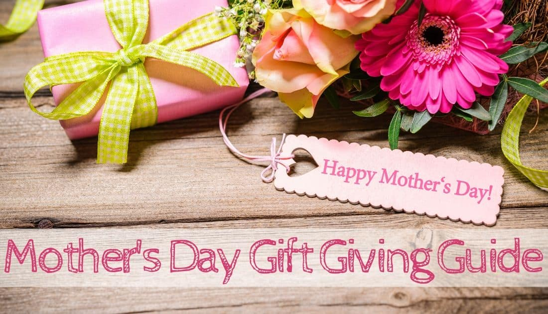 "gift wrapped in pink paper with Spring flower bouquet with tag that says ""Happy Mother's Day"""