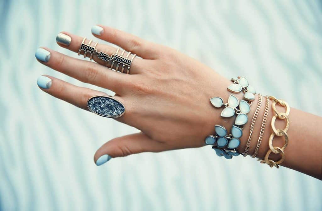 Woman's hand with all kinds of bracelets and rings on display