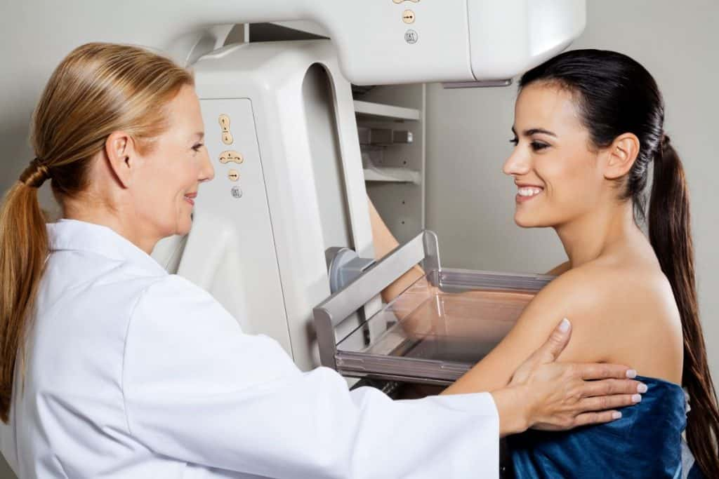 woman at annual appointment for a mamogram