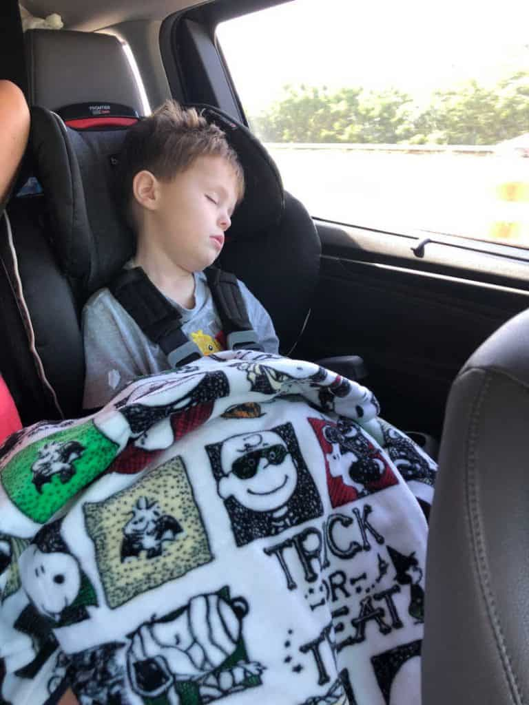 child asleep in car