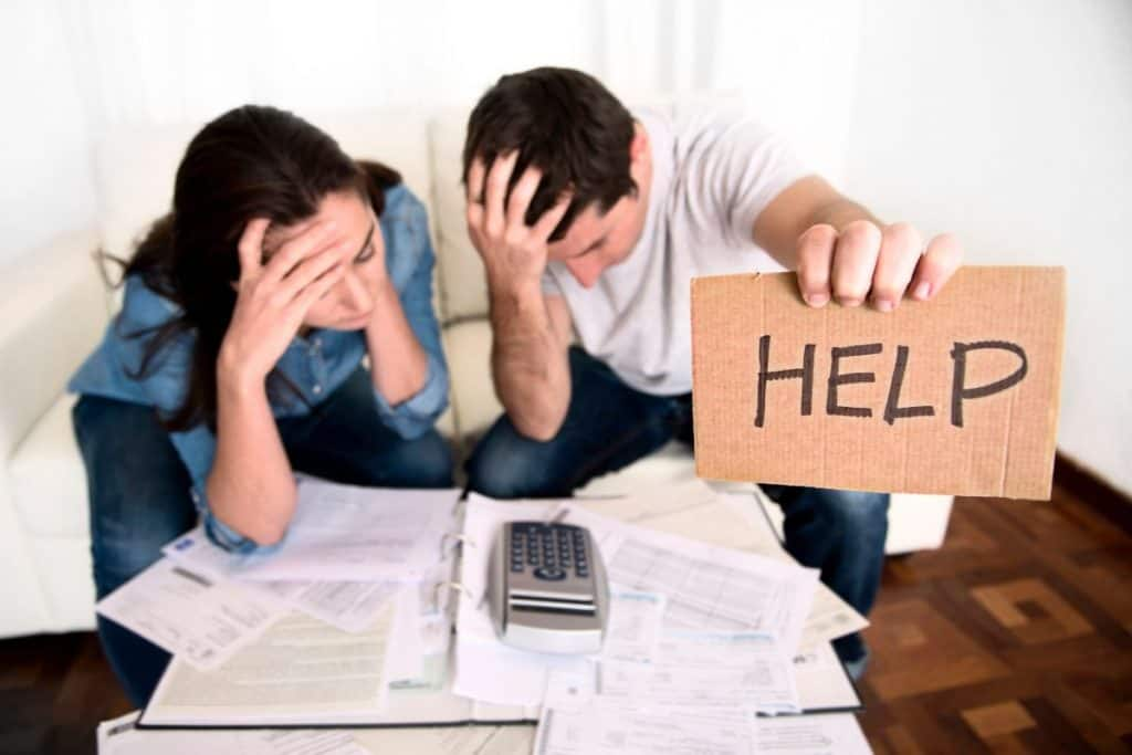 Couple needing help paying bills with debt