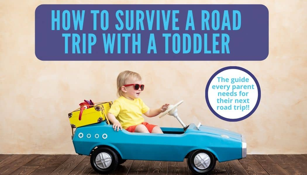 Toddler with sunglasses in a pedal car with suitcase and umbrella on back