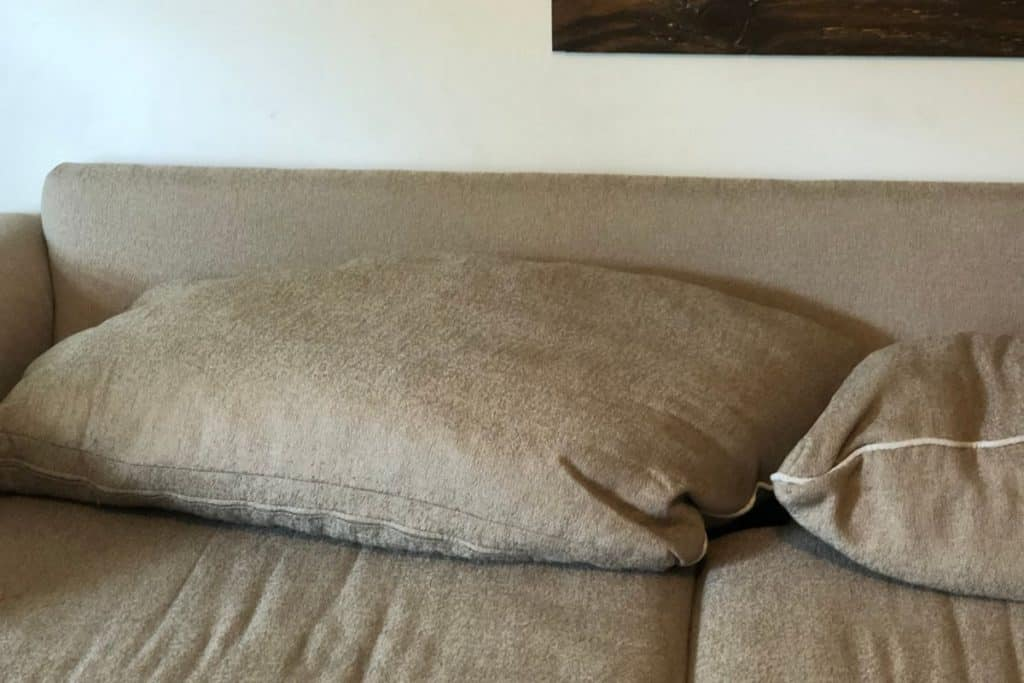 Couch with slouchy and lumpy cushions