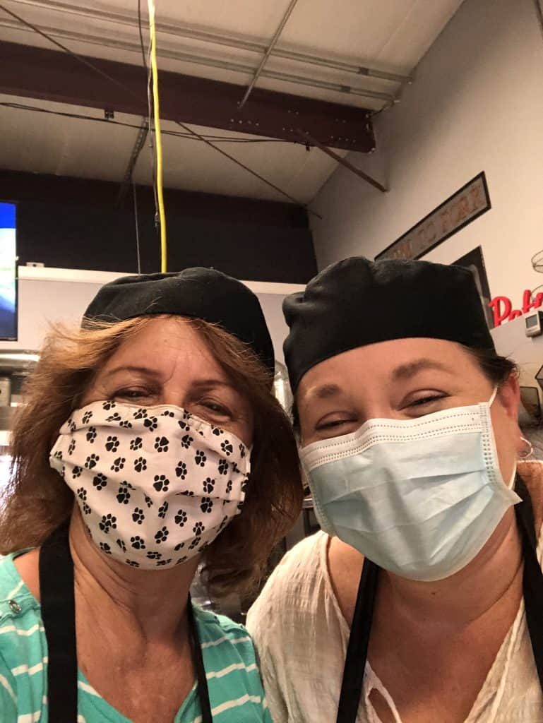 2 women in chef's hats and face masks