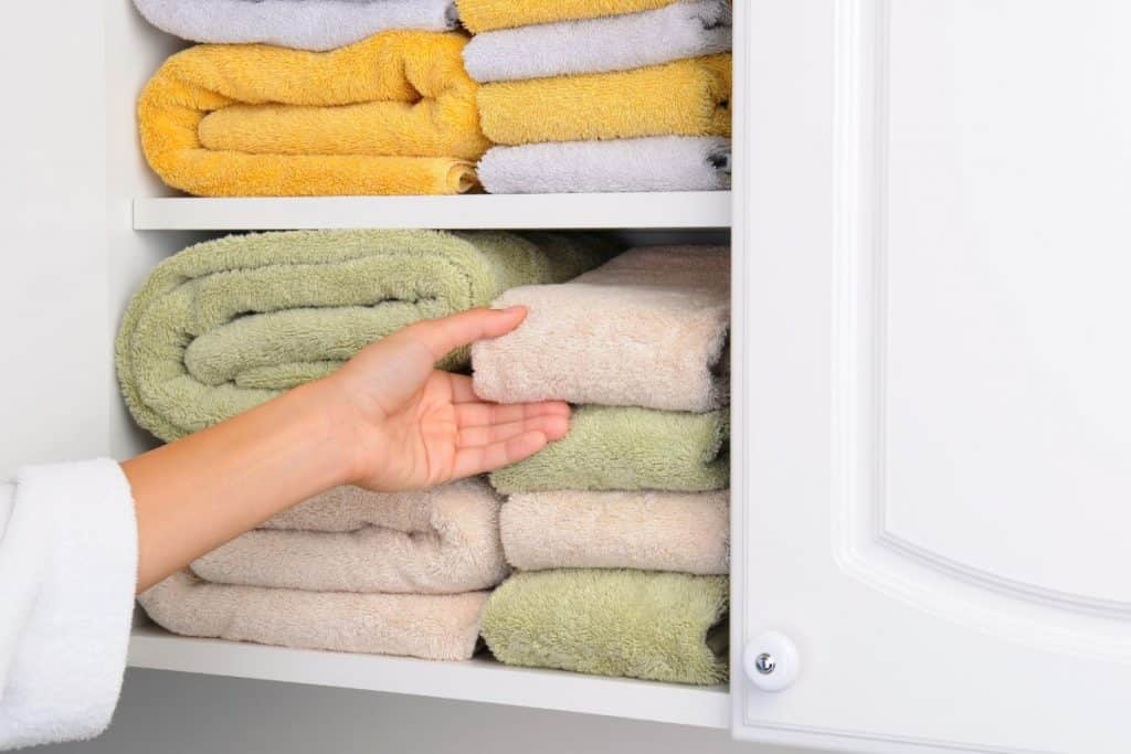 nicely organized linen closet
