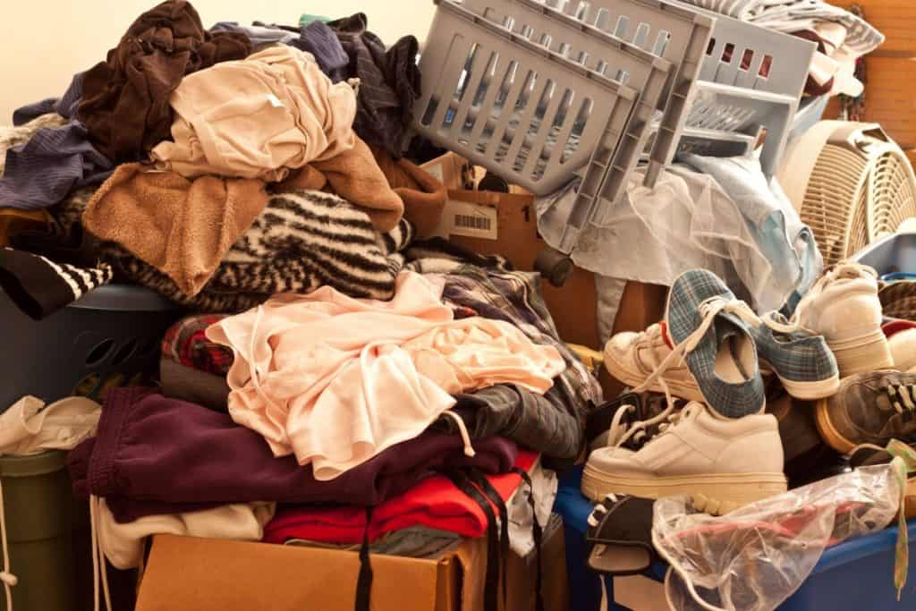 Messy pile of clothes and shoes