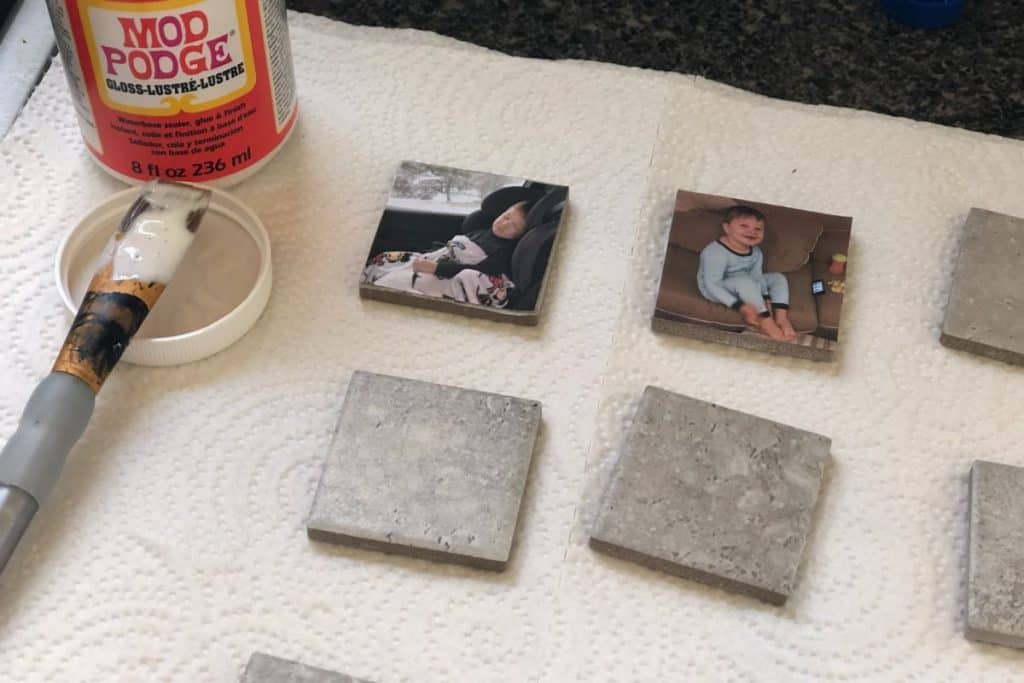 pictures glued to small square ceramic tiles