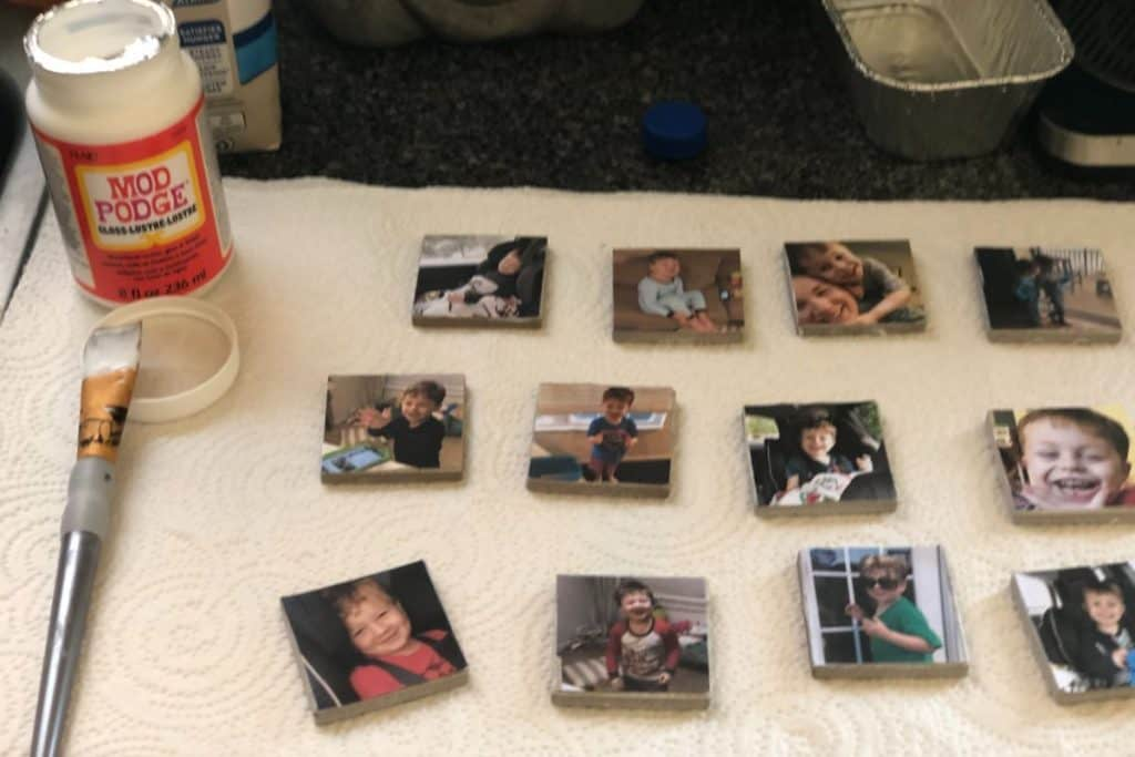 pictures glued onto small square ceramic tiles