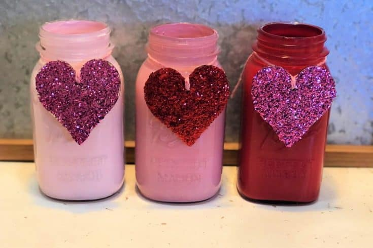 Valentine's Day Mason Jars with glitter hearts tied with pink twine