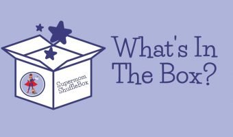 """Supermom Shufflebox cartoon box with label of """"What's IN The Box?"""""""