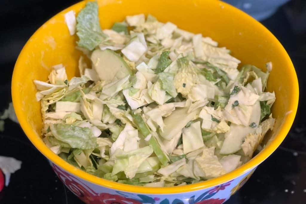 mixed up apple cabbage coleslaw with pineapple dressing