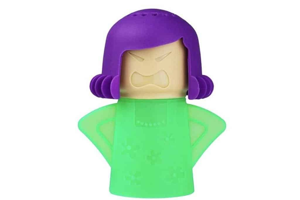 Microwave cleaner that looks like a mom with hands on hips with a green shirt and purple hair and holes in top of head for steam to come out