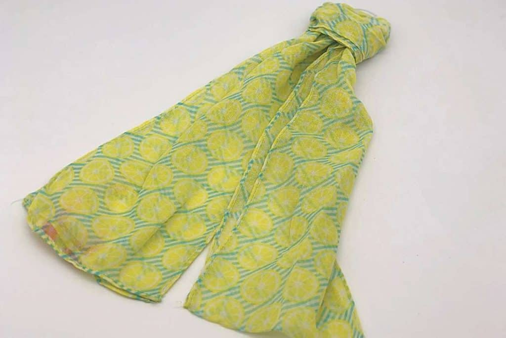scarf tied in knot with a lemon print on it