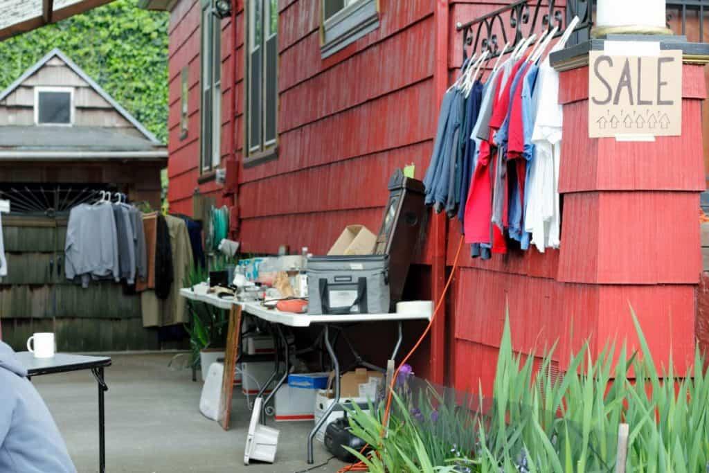 Yardsale items set up outside a house