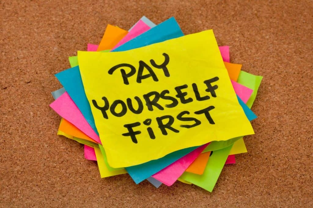 """stack of post it notes with top note saying """"Pay Yourself First"""""""