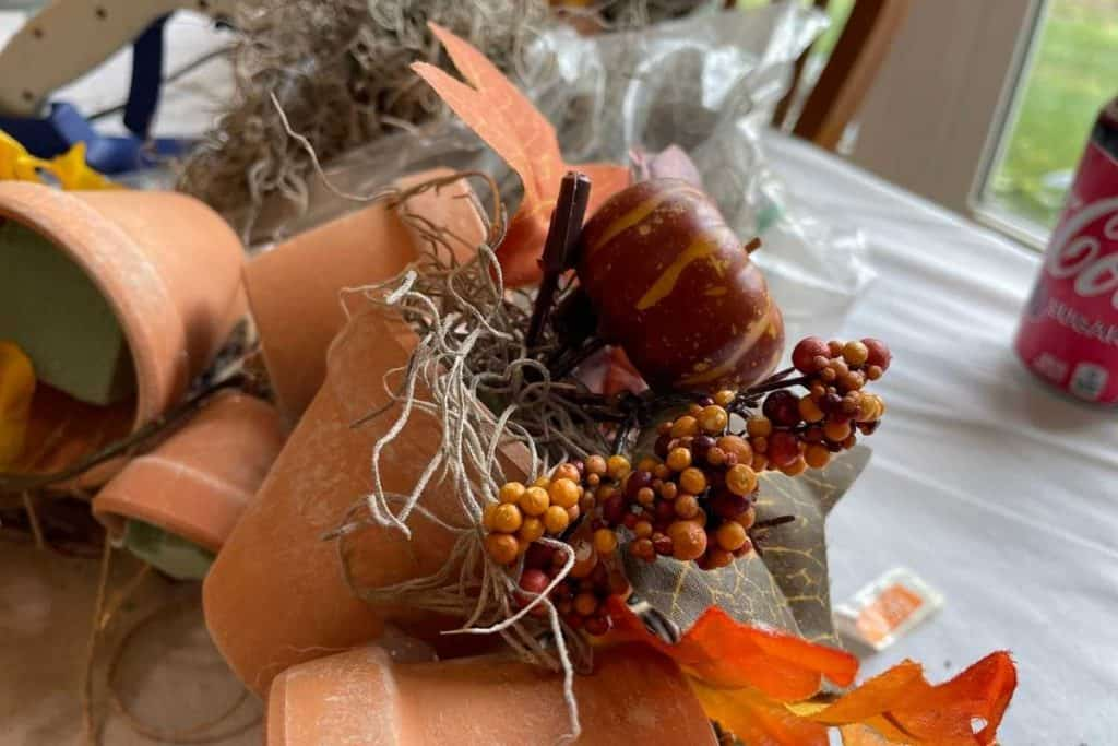 Artificial Fall pumpkin gourd and floral decor in a terracotta pot for Fall DIY Wreath project