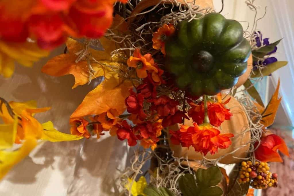 Green fake gourd with flowers for Fall DIY Wreath project
