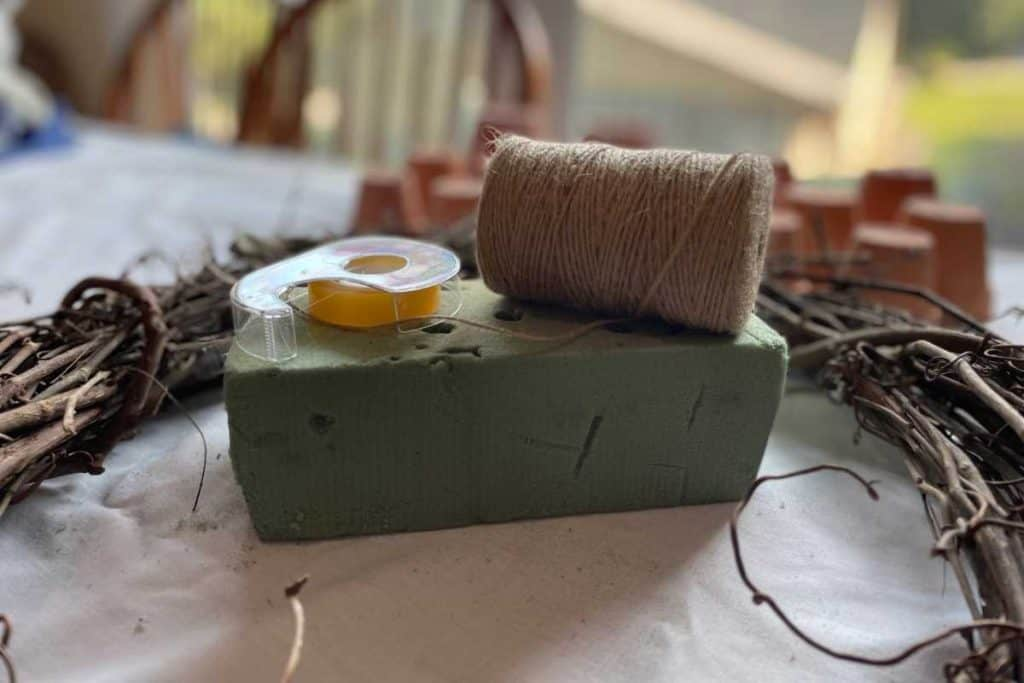 Floral foam, grapevine wreath, burlap twine and scotch tape for Fall DIY Wreath project