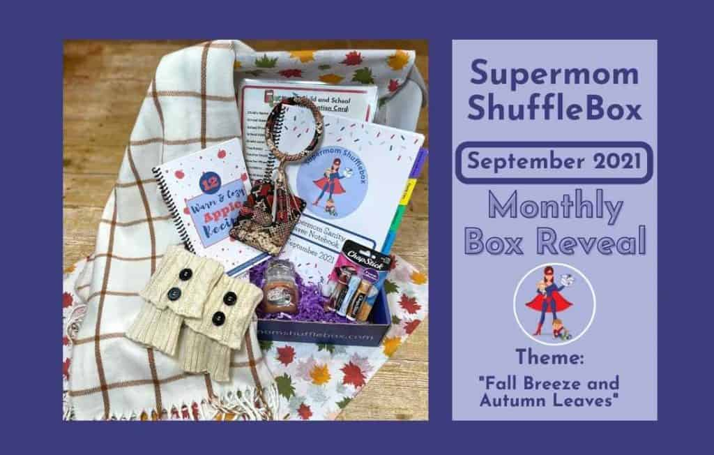A phot array of the Supermom ShuffleBox September contents, including white boot socks, a caramel pumpkin candle, a white and brown plaid scarf, a child info checksheet, a full box array picture, a pack of chapstick, a sprial bound Apple Recipe cookbook, a red and brown snakeskin bangle braclet ID holder and spriral bound workbooks